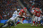Kansas City Chiefs Travis Kelce getting tackled during the Kansas City Chiefs v Detroit Lions  NFL International Series match at Wembley Stadium, London, England on 1 November 2015. Photo by Matthew Redman.