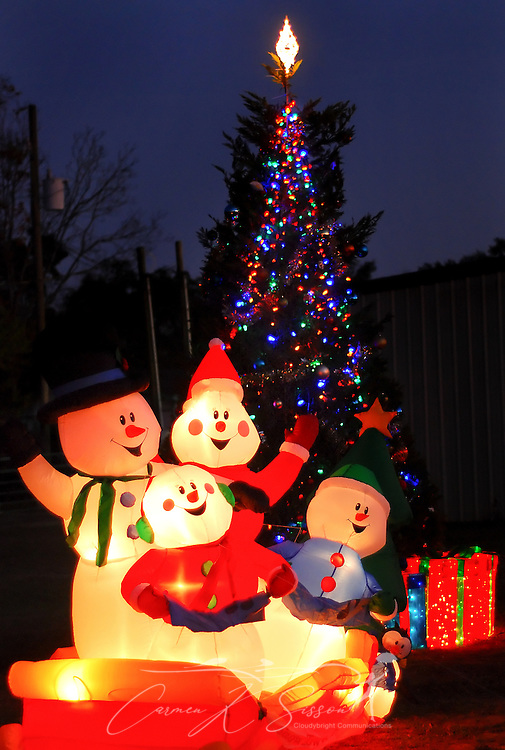 A lighted inflatable snowman family and a Christmas tree decorates the lawn beside City Hall in Bayou La Batre, Ala. Dec. 4, 2010. The Gulf Coast continues to recover from this summer's Deepwater Horizon BP oil spill, which affected nearly 29,000 square miles of shoreline from Louisiana to Florida. (Photo by Carmen K. Sisson/Cloudybright)