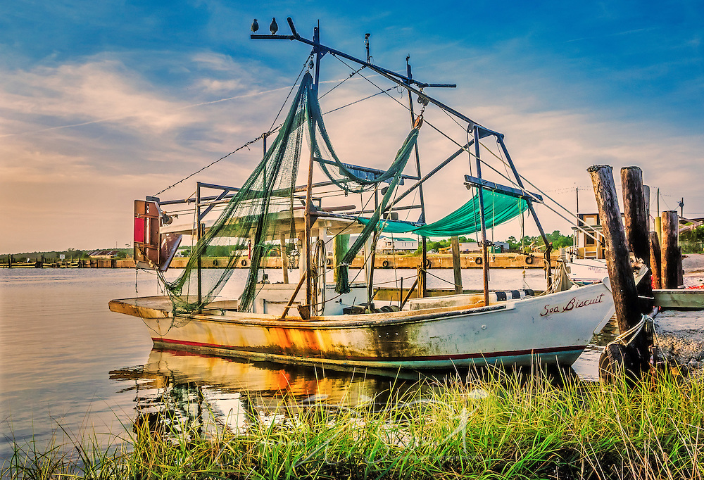The sun sets on the Sea Biscuit, Aug. 31, 2014, in Bayou La Batre, Alabama. (Photo by Carmen K. Sisson/Cloudybright)