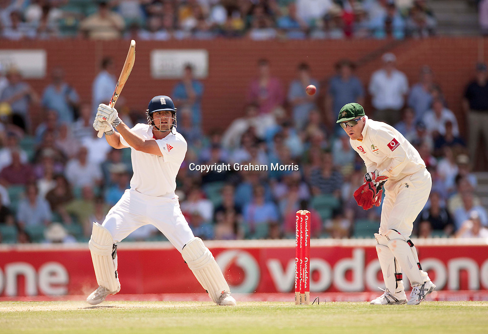 Alastair Cook heads towards his century with a four off Xavier Doherty past wicket keeper Brad Haddin in the second Ashes Test Match between Australia and England at the Adelaide Oval. Photo: Graham Morris (Tel: +44(0)20 8969 4192 Email: sales@cricketpix.com) 4/12/10