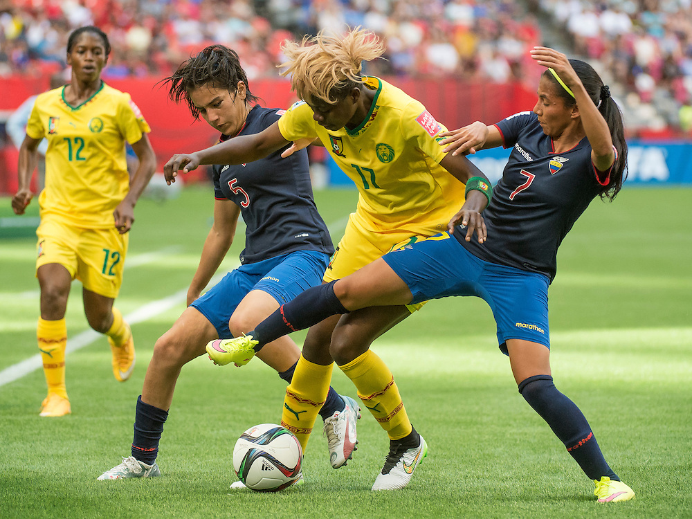 Claudine Meffometou of team Cameroon (#12-left) Mayra Olvera of team Ecuador, Gaelle Enganamouit of team Cameroon (middle #17)) and Ingrid Rodriguez of team Ecuador in 2015 women's World Cup Soccer in Vancouver during the first round action between Cameroon and Ecuador.