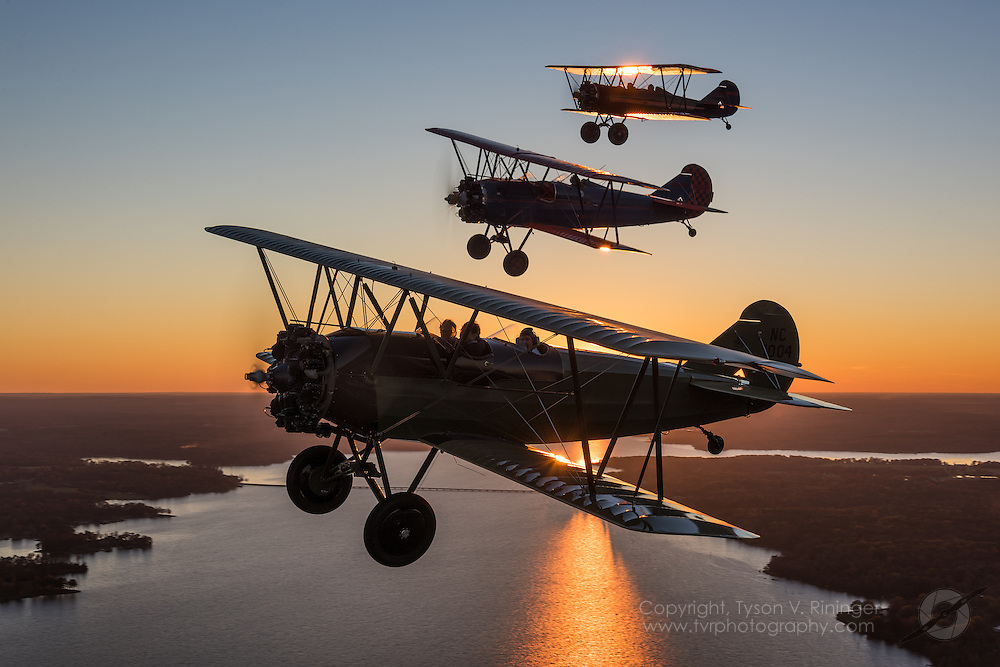 John E Mosley, David Mars and Kelly Mahon join up to create an extremely rare formation of three TravelAir 4000's with Matt Bongers flying the O-1 Bird Dog photo ship for the Mid America Flight Museum