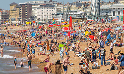 © Licensed to London News Pictures. 30/06/2016. Brighton, UK. Members of the public take advantage of the hot and sunny weather to spent time on the beach in Brighton and Hove.  Photo credit: Hugo Michiels/LNP