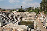 Bouleuterion or Odeon, 2nd - 3rd century AD, Aphrodisias, Aydin, Turkey. The Bouleuterion or Council House was like a town hall, serving as the meeting place of the city's administrative council or Boule, and as a multi-purpose indoor theatre, concert hall and assembly space. It is a semi-circular building with auditorium and stage, seating 1750. The additional 12 rows of seating and vaulted roof collapsed in an earthquake in the 4th century. In the 5th century it was altered into a palaestra. Aphrodisias was a small ancient Greek city in Caria near the modern-day town of Geyre. It was named after Aphrodite, the Greek goddess of love, who had here her unique cult image, the Aphrodite of Aphrodisias. The city suffered major earthquakes in the 4th and 7th centuries which destroyed most of the ancient structures. Picture by Manuel Cohen
