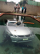 'Drunk driver' crashes car through cinder block wall and lands in family's pool<br /> <br /> The Diaz family awoke to an unexpected sight in their Southern California pool.<br /> On Sunday morning, they found a Lexus at the bottom of their pool, and it was clear that it had crashed through the cinder block barrier wall from the nearby intersection.<br /> They told the San Gabriel Valley Tribune that drivers had previously scraped the wall, but none had gone so far as Sunday's drunk driver.<br /> <br /> Modesto Cabral, 40, was arrested on suspicion on of driving under the influence.<br /> He had only minor injuries and was able to climb out of the car through the front right window once the 2006 Lexus crashed into the pool around 5.25am.<br /> <br /> 'We woke up to an awful noise and looked outside, and a car was in the pool,' Janelle Diaz told the paper.<br /> Cabral is being held on $10,000 bail, and his car has since been pulled out of the Diaz' pool by a crane.<br /> <br /> 'We had always joked about it- that someone was going to end up in the pool- because they've hit our wall before,' Ms Diaz said.<br /> Just three weeks ago a similar incident occurred in Florida when a man drove his 1967 Chevrolet Camaro into a backyard pool after swerving off a suburban Miami road.<br /> No one was hurt in that incident either, but the homeowner had an estimated $50,000 worth of damage done to his property.<br /> <br /> Photo Shows: Water landing: Modesto Cabral, 40, drove his 2006 Lexus through a cinder block wall and into a family's pool early Sunday morning<br /> ©Beatriz Diaz/Exclusivepix