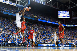 Kentucky forward Marcus Lee, left, slams on Ole Miss guard Martavious Newby in the second half. The University of Kentucky hosted Ole Miss, Saturday, Jan. 02, 2016 at Rupp Arena in Lexington.