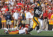 September 11 2010: Iowa Hawkeyes tight end Allen Reisner (82) is tripped up by Iowa State Cyclones cornerback Leonard Johnson (23) after a reception during the second half of the NCAA football game between the Iowa State Cyclones and the Iowa Hawkeyes at Kinnick Stadium in Iowa City, Iowa on Saturday September 11, 2010. Iowa defeated Iowa State 35-7.