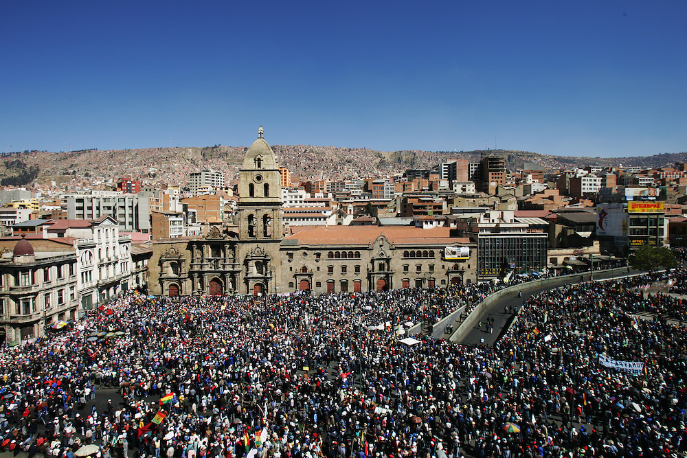 People gather to protest in La Paz, Bolivia. Three weeks of protests that have rocked Bolivia led to President Mesa offering his resignation, for the second time this year, to congress. Blockades, protests and concentrations have brought the country to a standstill and confrontations between police and protestors happen daily.  At the center of the conflict is the indigenous movement's desire to nationalize gas and rewrite the constitution. Congress must now meet to decide of they will accept the president's resignation.