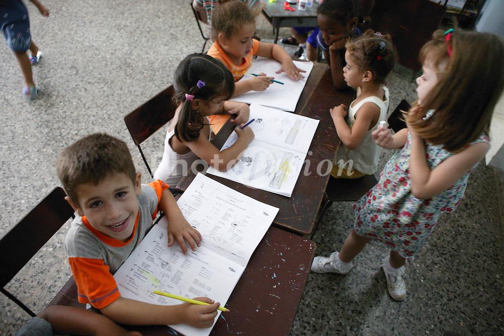 Children with crayons at Havana nursery school,