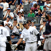 NEW YORK, NEW YORK - July 10: New York Yankee fans cheers a Brett Gardner #11 of the New York Yankees home run during the Boston Red Sox Vs New York Yankees regular season MLB game at Yankee Stadium on July 10, 2016 in New York City. (Photo by Tim Clayton/Corbis via Getty Images)