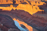 View down to the Colorado River at sunrise from overlook at Dead Horse Point State Park Utah