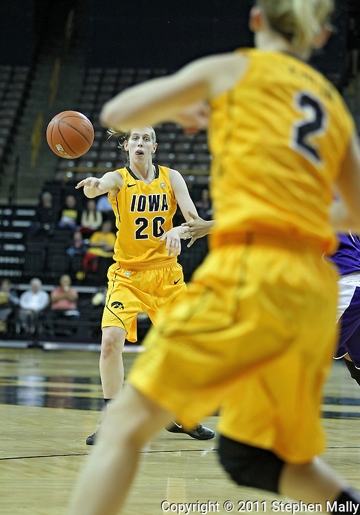 December 30, 2011: Iowa Hawkeyes forward Kelly Krei (20) passes the ball to Iowa Hawkeyes guard Kamille Wahlin (2) during the NCAA women's basketball game between the Northwestern Wildcats and the Iowa Hawkeyes at Carver-Hawkeye Arena in Iowa City, Iowa on Wednesday, December 30, 2011.