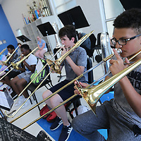 Atheer Elmaghraby, 14, plays his trumbone during Friday's band camp at Tupelo High School.