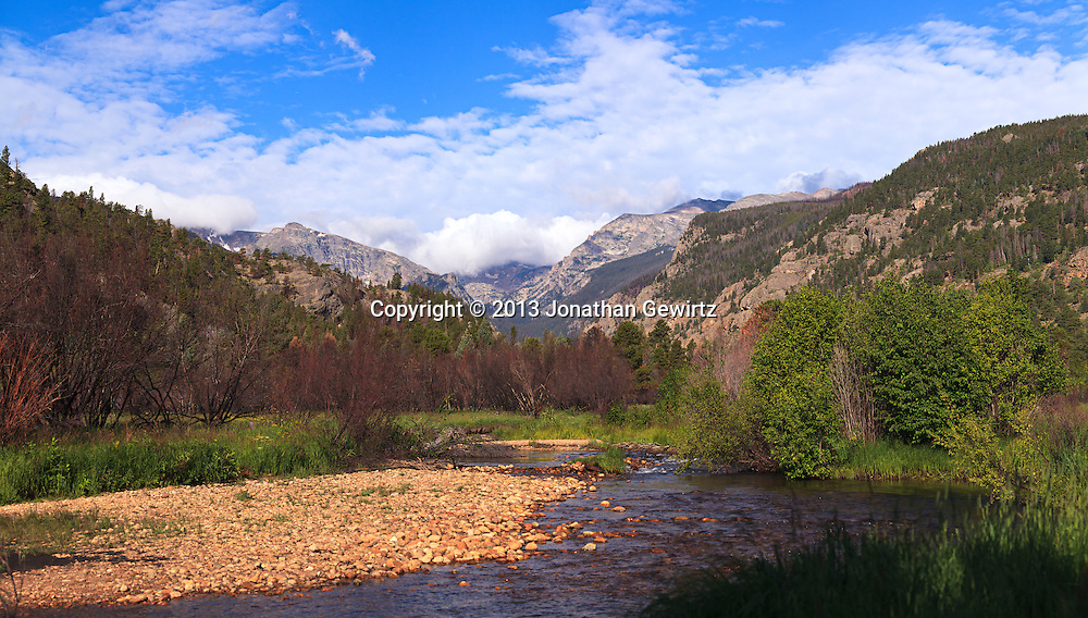 Majestic mountains overlook a tranquil meadow and stream in Rocky Mountain National Park near Estes Park, Colorado. WATERMARKS WILL NOT APPEAR ON PRINTS OR LICENSED IMAGES.