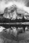 El Capitan and clouds reflect peacefully in the Merced River. Yosemite National Park, California.