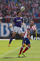Atletico de Madrid´s Gabi (R) and Espanyol´s Alvarez during 2014-15 La Liga Atletico de Madrid V Espanyol match at Vicente Calderon stadium in Madrid, Spain. October 19, 2014. (ALTERPHOTOS/Victor Blanco)