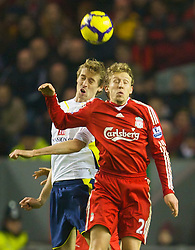 LIVERPOOL, ENGLAND - Wednesday, January 20, 2010: Liverpool's Lucas Leiva and Tottenham Hotspur's Peter Crouch in action during the Premiership match at Anfield. (Photo by: David Rawcliffe/Propaganda)