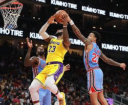 February 12, 2019 - Atlanta, GA, USA - Atlanta Hawks forward John Collins blocks a shot by Los Angeles Lakers' LeBron James during the second half on Tuesday, Feb. 12, 2019 in Atlanta, Ga. (Credit Image: © Curtis Compton/Atlanta Journal-Constitution/TNS via ZUMA Wire)