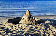 Sand castle along the ocean edge, Cape Cod, MA, USA