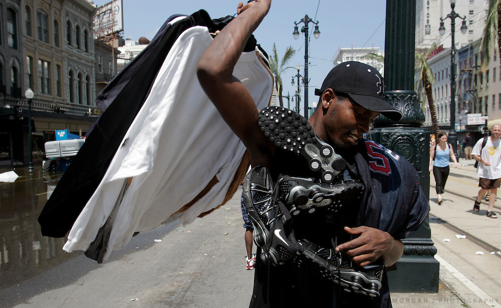 Alan White, 25, loads himself down with looted clothes and shoes Wednesday, August 31, 2005, on Canal Street in New Orleans, La. White said he made his way through water for four hours before getting downtown. Scott Morgan