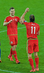 CARDIFF, WALES - Tuesday, October 13, 2015: Wales' Sam Vokes and Gareth Bale celebrate on the pitch after qualifying for the finals following a 2-0 victory over Andorra during the UEFA Euro 2016 qualifying Group B match at the Cardiff City Stadium. (Pic by Paul Currie/Propaganda)