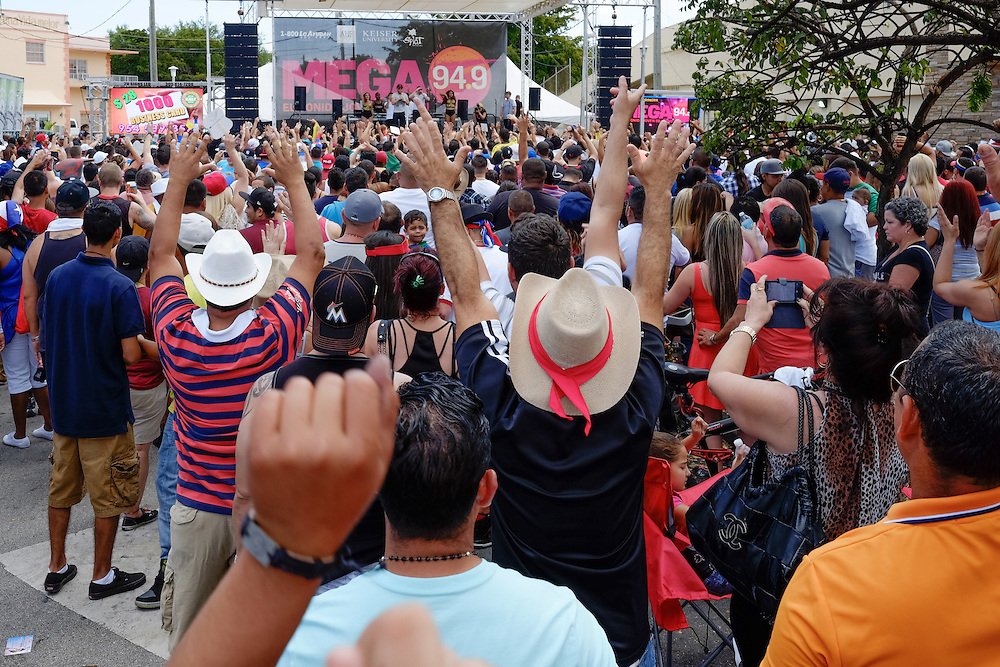 MIAMI - MARCH 9, 2014: People enjoys of the many live performances at one of the stages during the 37th Calle Ocho festival, an annual event that takes place over Eight Street in Little Havana featuring plenty of music, food, and  it is the biggest party in town that celebrates hispanic heritage.
