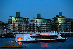 UK ENGLAND LONDON 2FEB14 - City Cruises pleasure boat passes modern residential devleopment in the docklands near Tower Bridge, central London.<br /> <br /> <br /> <br /> jre/Photo by Jiri Rezac<br /> <br /> © Jiri Rezac 2014