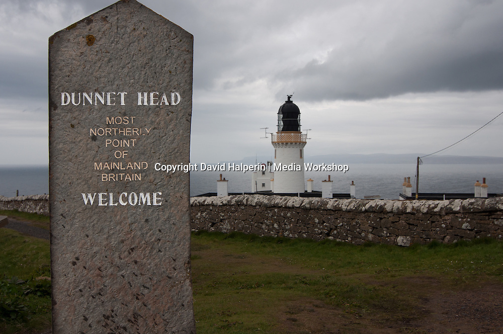 Dunnet Head Lighthouse & marker. Northernmost point on mainland UK. Orkney in distance.