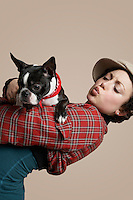Young woman holding French Bulldog