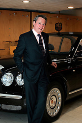 UK ENGLAND CREWE 5APR06 - Dr Franz-Josef Paefgen, Chairman and Chief Executive, Bentley Motors poses for a portrait at a clay model of Her Majesty Queen Elizabeth II state limousine made by the Bentley Factory in Crewe. Since the de-merger of Bentley and Rolls Royce Motors in 2002, VW-owned Bentley has retained the Royal Warrant as Her Majesty Queen Elizabeth II official supplier...jre/Photo by Jiri Rezac..© Jiri Rezac 2006..Contact: +44 (0) 7050 110 417.Mobile:  +44 (0) 7801 337 683.Office:  +44 (0) 20 8968 9635..Email:   jiri@jirirezac.com.Web:    www.jirirezac.com..© All images Jiri Rezac 2006 - All rights reserved.