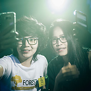 Bangkok, April 7, 2017 - Honeymoon Tomboy Club RCA, TomBoy and Dee during a Selfie, A dee will look, act, and speak in a manner congruent with Thai female gender norms. The only difference between dees and traditional females is that dee often engage in relationships with toms.<br /> Thailand's 'tom' (as in tomboys) inhabit a unique place on the gender spectrum. They are girls who dress and act in a masculine way, typically sporting a uniform look of short hair, t-shirts and jeans. But toms don't consider themselves trans or even lesbians, despite the fact that they date women (often girly 'dees' or other toms). <br /> <br /> You can&rsquo;t choose how you&rsquo;re born, but you can choose how to live your life. Thailand seems to be the most tolerant place for the LGBTI (lesbian, gay, bisexual, transgender, intersex ) community. However, tolerance doesn&rsquo;t mean acceptance. For the LGBTI people who have already revealed their gender identity tend to often be the ones that have been mistreated by the general public and the media due to the lack of knowledge and understanding. In Thai society, transmen are still in the shadow of &lsquo;tomboy&rsquo; culture. While the terms of &lsquo;transwoman&rsquo; and &lsquo;tomboy&rsquo; have been well known among Thai people for many decades, the term of &lsquo;transman&rsquo; only been introduced about 5 years ago. &ldquo;Phu Chai Kham Phej&rdquo; is a Thai term that has been translated from a western term &lsquo;transman&rsquo; which means a transgender person who was assigned female at birth but whose gender identity is that of a man. &copy; Jean-Michel Clajot
