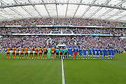 The teams line-up for a minute's applause as part of the tribute to Matt Grimstone and Jacob Schilt who were killed in the Shoreham air disaster during the Sky Bet Championship match between Brighton and Hove Albion and Hull City at the American Express Community Stadium, Brighton and Hove, England on 12 September 2015. Photo by Bennett Dean.
