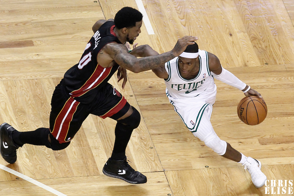 03 June 2012: Boston Celtics point guard Rajon Rondo (9) drives past Miami Heat power forward Udonis Haslem (40) during the second quarter of Game 4 of the Eastern Conference Finals playoff series, Heat at Celtics, at the TD Banknorth Garden, Boston, Massachusetts, USA.