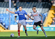 Portsmouth defender Christian Burgess holds off Notts County Forward Jon Stead during the Sky Bet League 2 match between Portsmouth and Notts County at Fratton Park, Portsmouth, England on 25 March 2016. Photo by Adam Rivers.