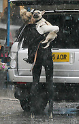 02.OCTOBER.2012. LONDON<br /> <br /> SARAH HARDING GETS CAUGHT IN A RAIN STORM WHILST TAKING HER DOG OUT THE CAR NEAR HER HOUSE.<br /> <br /> BYLINE: EDBIMAGEARCHIVE.CO.UK<br /> <br /> *THIS IMAGE IS STRICTLY FOR UK NEWSPAPERS AND MAGAZINES ONLY*<br /> *FOR WORLD WIDE SALES AND WEB USE PLEASE CONTACT EDBIMAGEARCHIVE - 0208 954 5968*