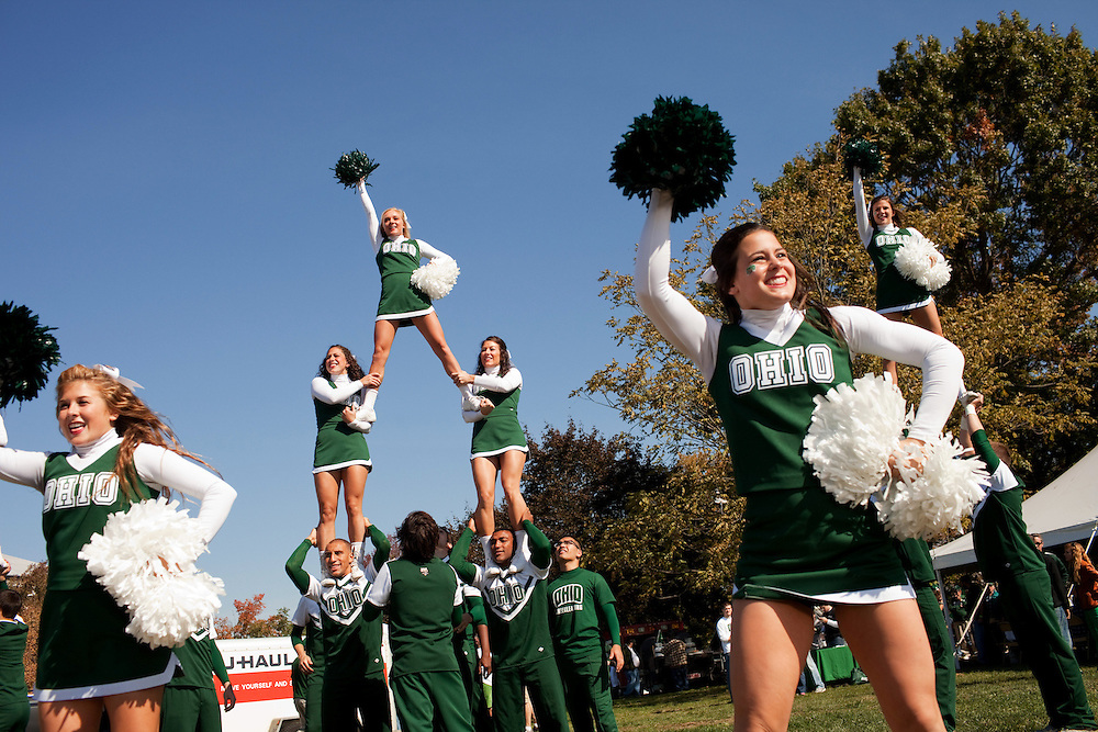 The Ohio University Cheer Team visits tailgating parties during homecoming weekend on Saturday, October 13, 2012..Photo by Chris Franz