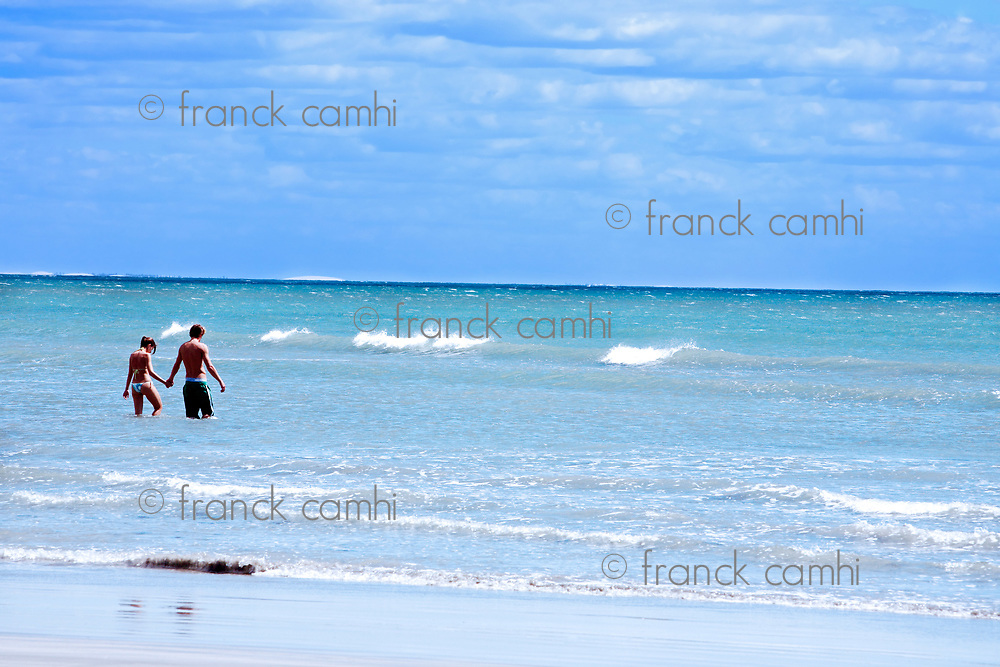 couple walking on the beach of the beautiful fisherman village of Jericoacoara in ceara state brazil