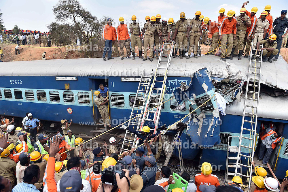 Rescuers cut the outer shell of a crumbled compartment of a derailed train to pull out the body of a victim near Anekal, about 40 kilometers south of Bangalore, India, Feb. 13, 2015. At least 12 people were killed and more than 150 others injured in a train derailment in the southern Indian state of Karnataka on Friday, a senior police officer said. EXPA Pictures © 2015, PhotoCredit: EXPA/ Photoshot/ Stringer<br /> <br /> *****ATTENTION - for AUT, SLO, CRO, SRB, BIH, MAZ only*****