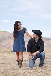 girl admiring a cowboy outdoors