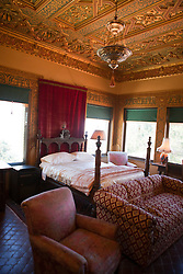 Interior bed room of Casa del Sol guesthouse, Hearst Castle, California, United States of America