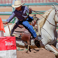 080515       Cable Hoover<br /> <br /> Clint Etcitty reaches for the flag as he rounds the flag racing barrel during the IJRA rodeo Wednesday at Red Rock Park in Gallup.