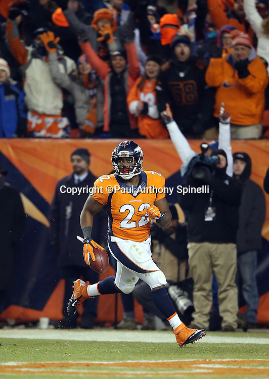 Denver Broncos running back C.J. Anderson (22) runs through the end zone after scoring a fourth quarter touchdown during the 2015 NFL week 16 regular season football game against the Cincinnati Bengals on Monday, Dec. 28, 2015 in Denver. The Broncos won the game in overtime 20-17. (©Paul Anthony Spinelli)