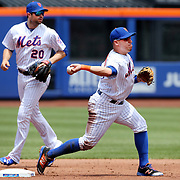 NEW YORK, NEW YORK - June 01:  Asdrubal Cabrera #13 of the New York Mets and Neil Walker #20 of the New York Mets turing a double play during the Chicago White Sox  Vs New York Mets regular season MLB game at Citi Field on June 01, 2016 in New York City. (Photo by Tim Clayton/Corbis via Getty Images)
