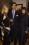 Amanda Ajram, Prince Casimir zu Sayn Wittgenstein  and emma Langwith, Opening of a Tod's boutique, Old Bond St. 19 Nov 2003. © Copyright Photograph by Dafydd Jones 66 Stockwell Park Rd. London SW9 0DA Tel 020 7733 0108 www.dafjones.com