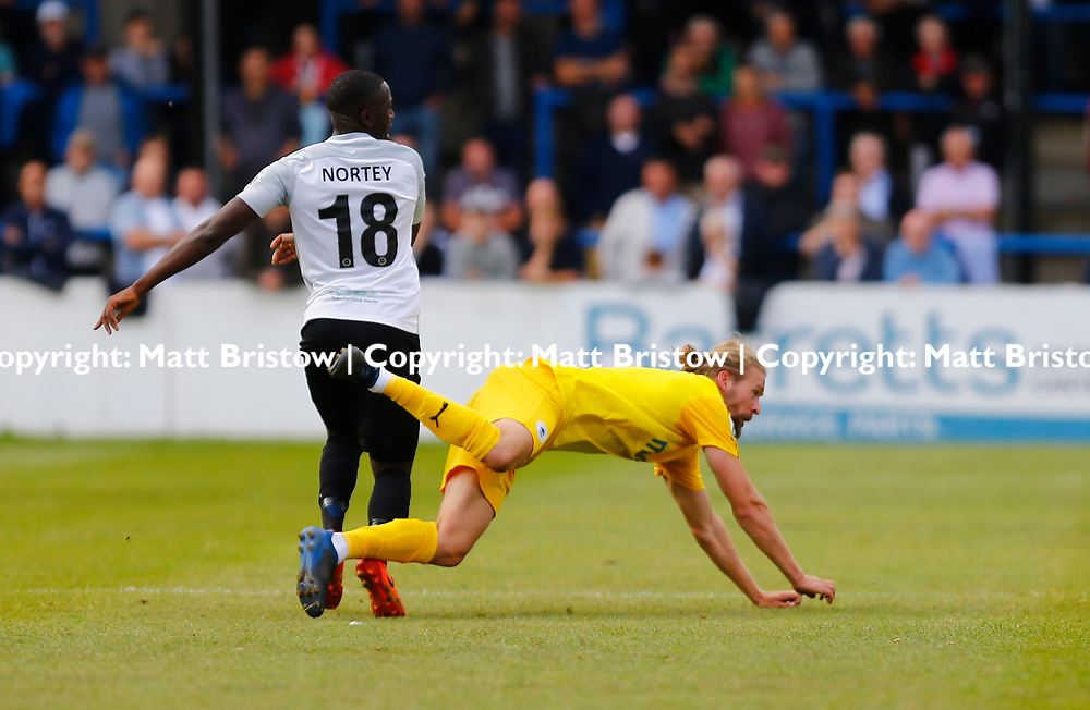 SEPTEMBER 1y6:  Dover Athletic against Chester FC in Conference Premier at Crabble Stadium in Dover, England. Doveer ran out emphatic winners 4 goal to nothing. Dover's midfielder Nortei Nortey knocks Chester's Kingsley james to the ground. (Photo by Matt Bristow/mattbristow.net)