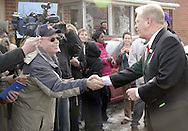 Gov. Ted Strickland (right) shakes hands at a Hillary Clinton campaign stop at the Fair River Oaks Council (FROC) office in Dayton, Thursday, February 14, 2008.