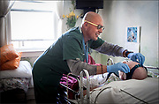 Client: California Pacific Medical Center Annual Report -- A nurse looks after Richard, a patient at the Coming Home Hospice, in San Francisco.