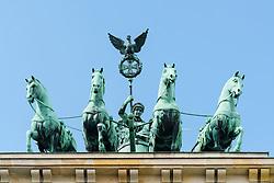 Detail of Quadriga statue on top of Brandenburg Gate in Berlin, Germany