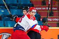 KAMLOOPS, CANADA - NOVEMBER 5:  Ivan Muranov #23 of Team Russia checks Calen Addison #3 of Team WHL on November 5, 2018 at Sandman Centre in Kamloops, British Columbia, Canada.  (Photo by Marissa Baecker/Shoot the Breeze)