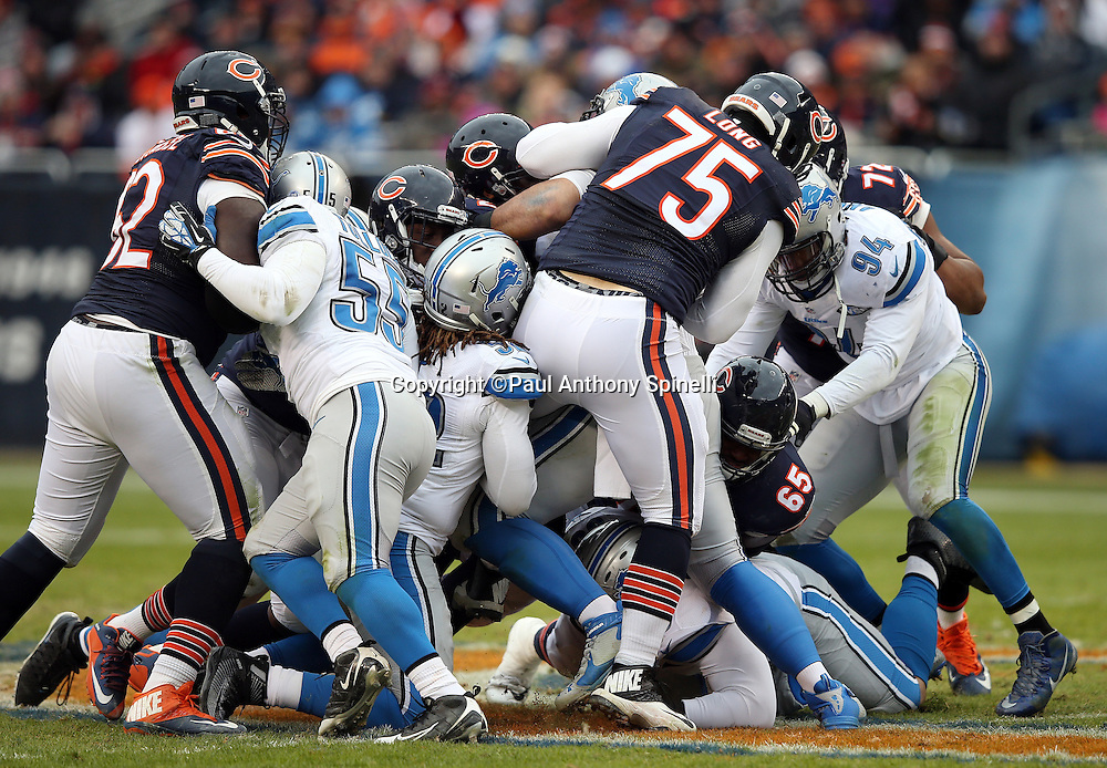 Chicago Bears offensive tackle Kyle Long (75) gets caught in the middle of a scrum during the NFL week 17 regular season football game against the Detroit Lions on Sunday, Jan. 3, 2016 in Chicago. The Lions won the game 24-20. (©Paul Anthony Spinelli)